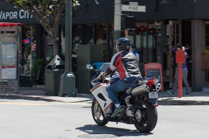 Motorcycle crossing Pine Street.