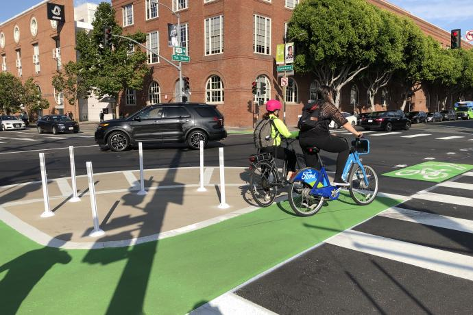 image of two people bicycling across the 7th Street & Townsend Street intersection