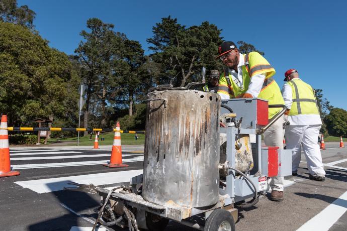 Crosswalks being painted inside Golden Gate Park