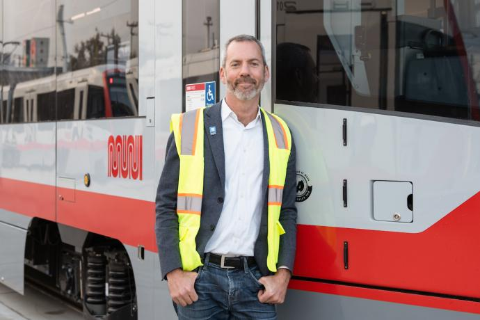 Jeff Tumlin standing next to a LRV4