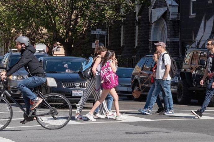 People using the crosswalk