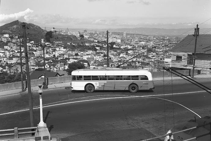 33 ashbury coach with city skyline in background, 1947