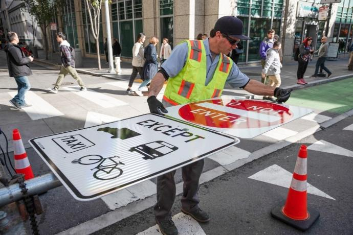Crews installed signs along side streets in preparation for the changes on January 29.