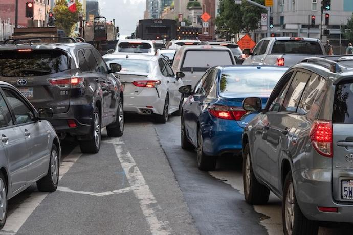 Cars merging in downtown traffic