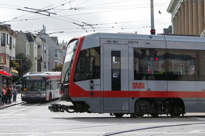 N Judah making the turn and a 6 coach picking people up.