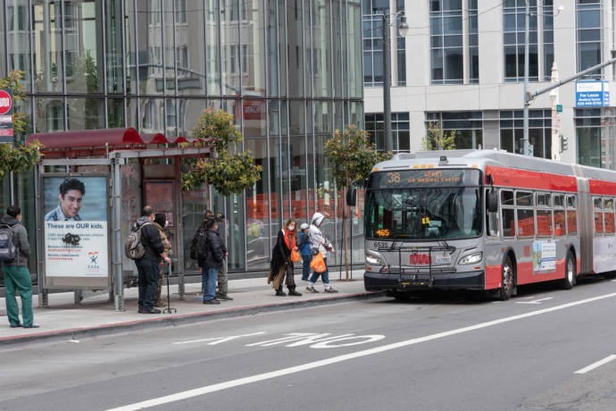 Passengers board 38 Geary on Geary at Van Ness