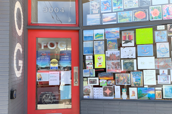 Fog storefront with art in the window
