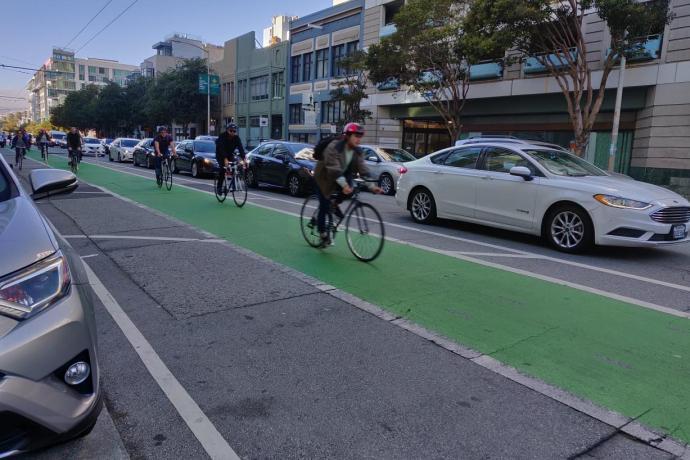 Bikers using the bike lanes on Folsom Street