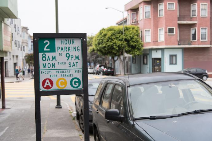 A picture of a residential parking sign