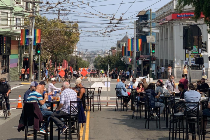 People enjoy the Shared Space at 18th and Castro streets