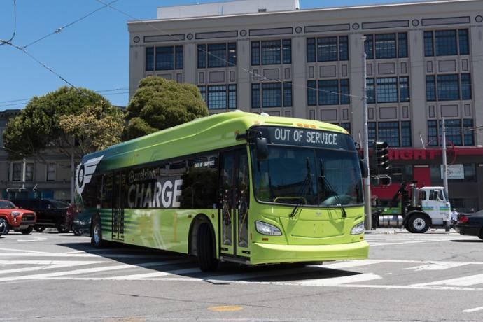 A battery electric bus turns from Mission on to South Van Ness