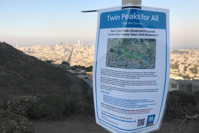 Twin Peaks flyer on top of Twin Peaks overlooking San Francisco