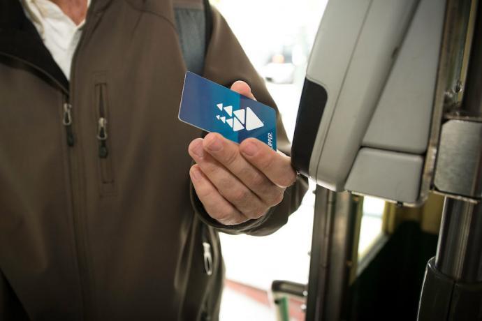 A customer pays their fare with a clipper card