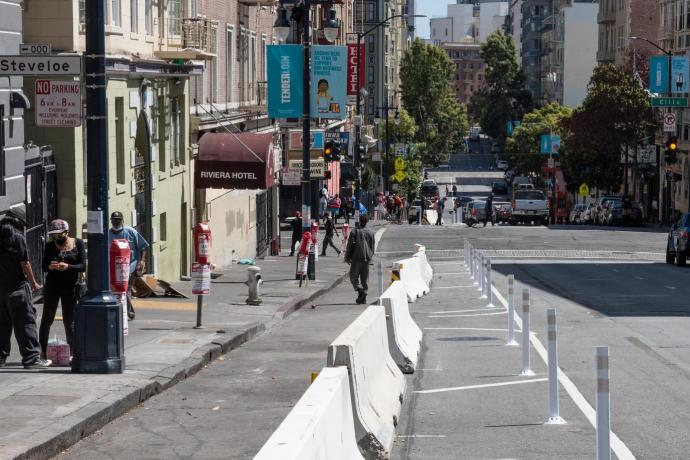 People using the physical distancing lane on Jones Street