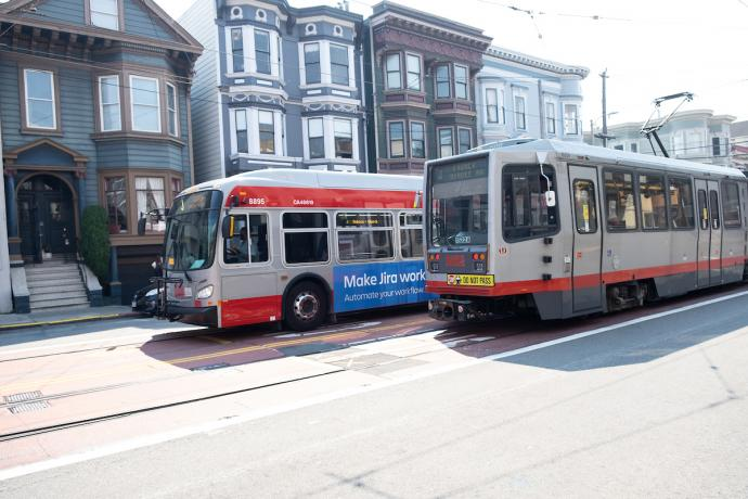 Photo of a Muni bus and Muni Metro side by side