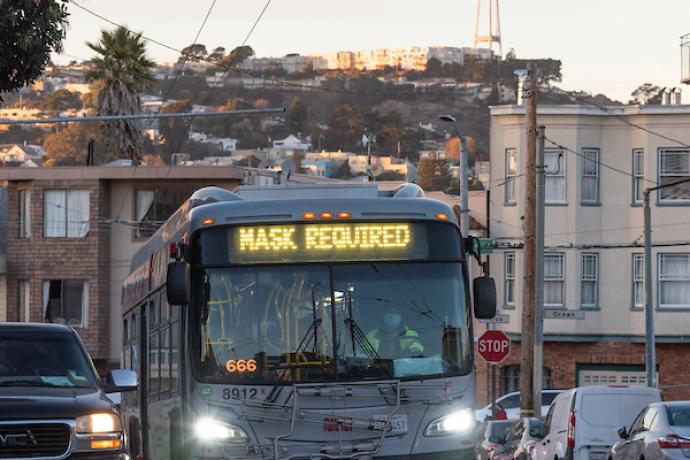 """A Muni Bus with a """"Mask Required"""" head sign."""