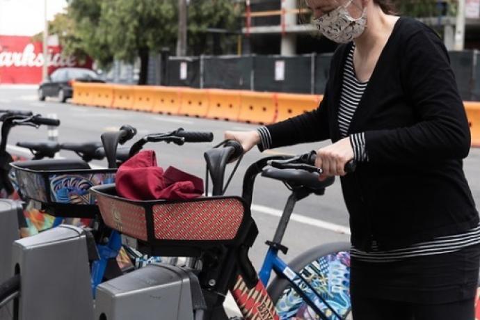 Woman using bikeshare station