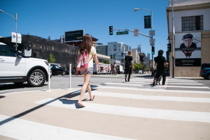 People using pedestrian safety zone on 8th Street that creates a shorter and safer crosswalk