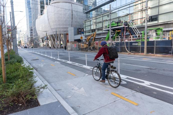 person biking in a two-way bikeway on Beale Street