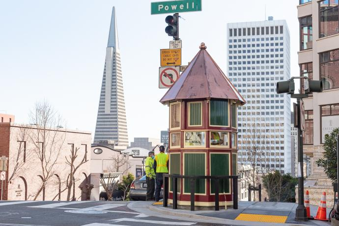 cable car signal tower with transamerica building in background