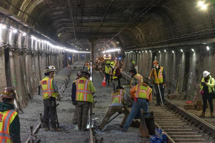 Workers laying track in the Twin Peaks tunnel