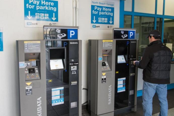 Customer using new PARCS kiosk at North Beach parking garage