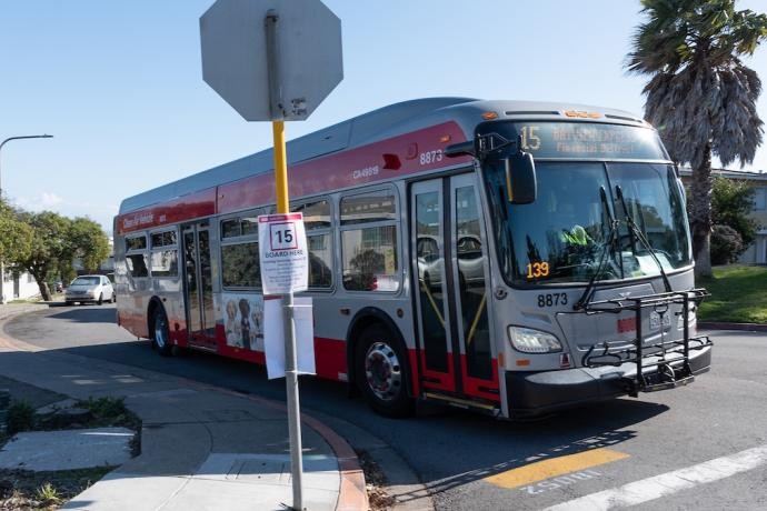 Image of 15 Express bus with temporary signage indicating new stop