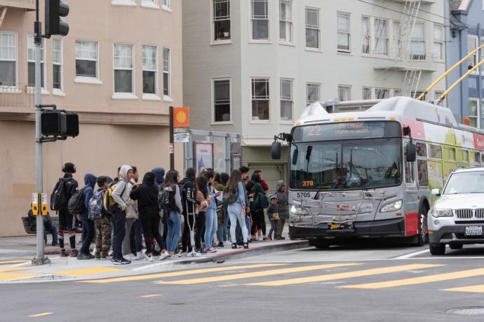 Students board a Muni bus