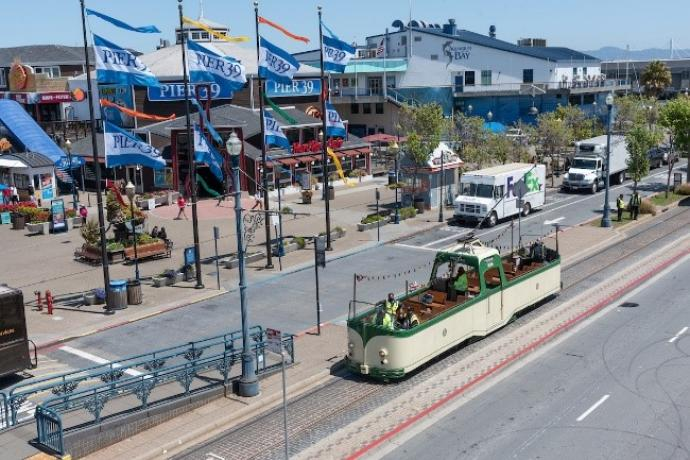 """Photo of Pier 39 with historic """"boat car"""" tram"""