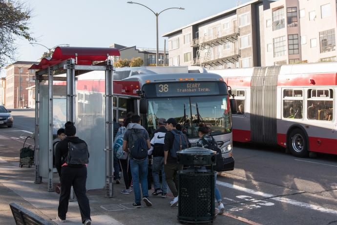 Students boarding the 38 Geary