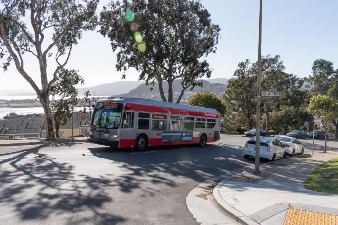 15 Bayview Hunters Point bus traveling on a street in Bayview