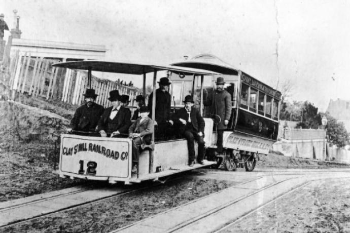 Photo of original cable car in late 1800s with male passengers on board