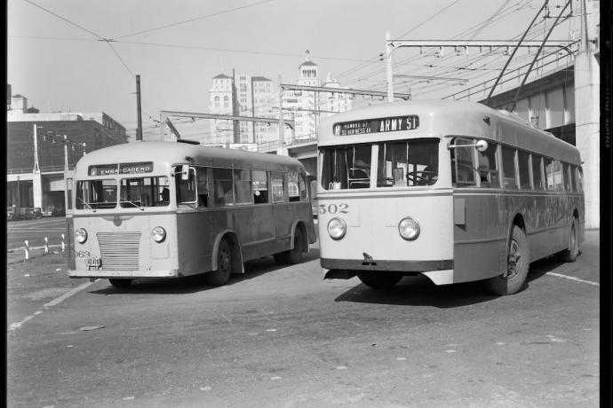 """Two Muni buses lay over at the """"Bridge Terminal"""" at Beale and Howard Streets in this November 1941 photograph"""
