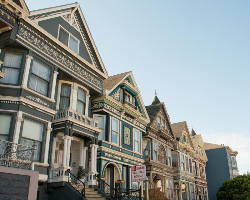 Color photograph of a row of decorated victorian era houses in the Haight Ashbury neighborhood.