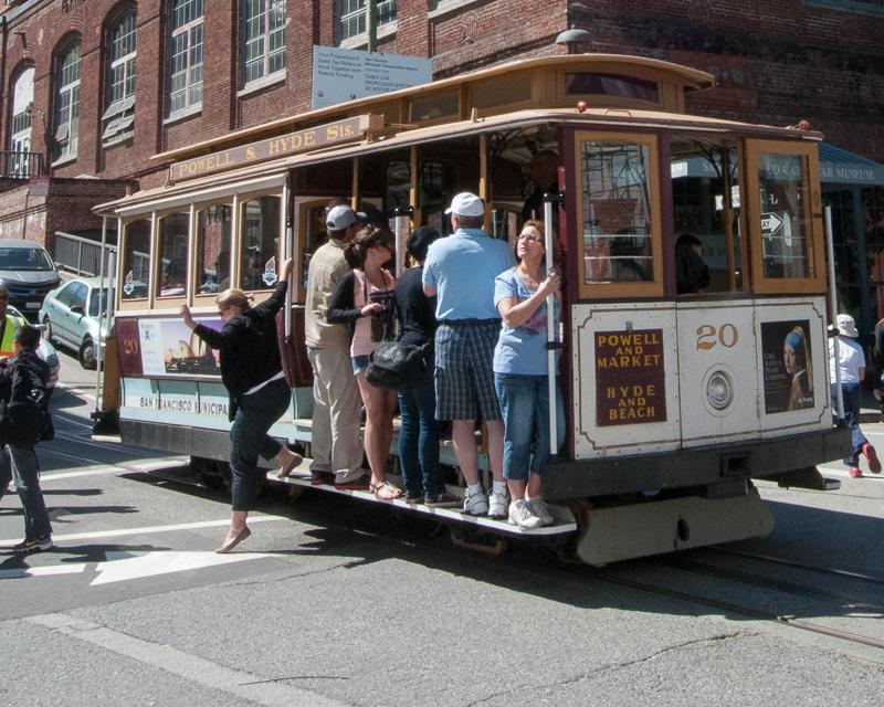 People alighting from Cable Car at Washington and Mason Streets
