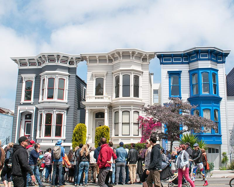 Sunday Streets event on Valencia Street in front of iconic San Francisco Victorian buildings