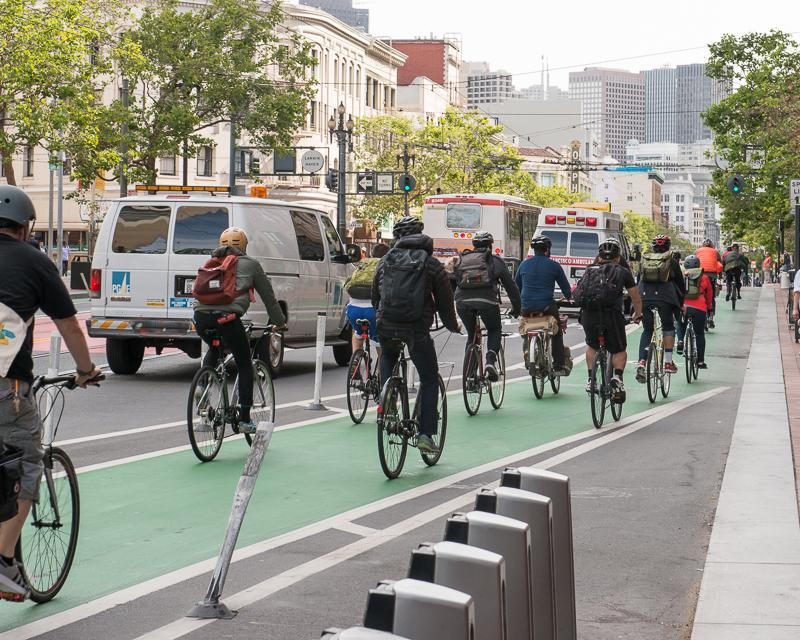 line of cyclists in green bike lane on Market Street