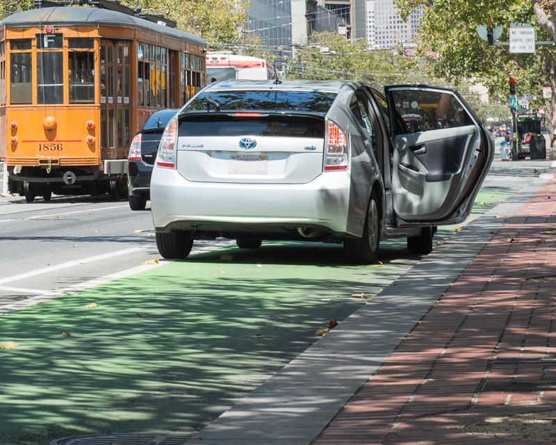 Uber driver blocking bike lane on Market Street while illegally loading passenger