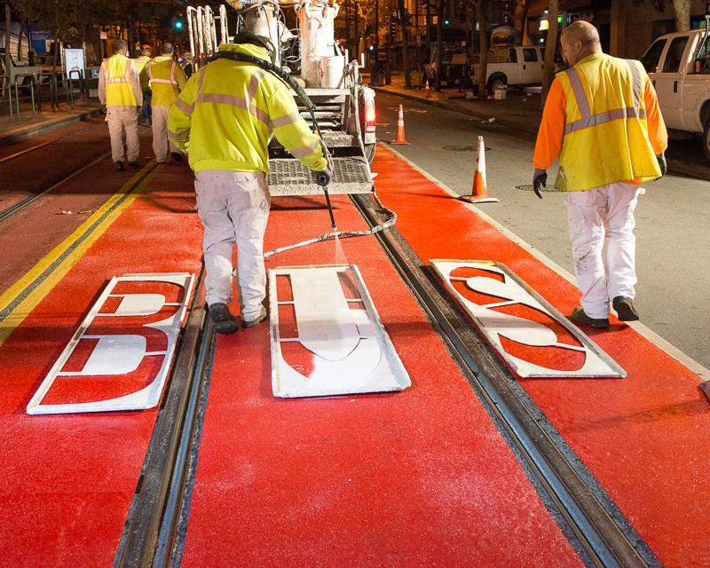 paint crews painting bus lane