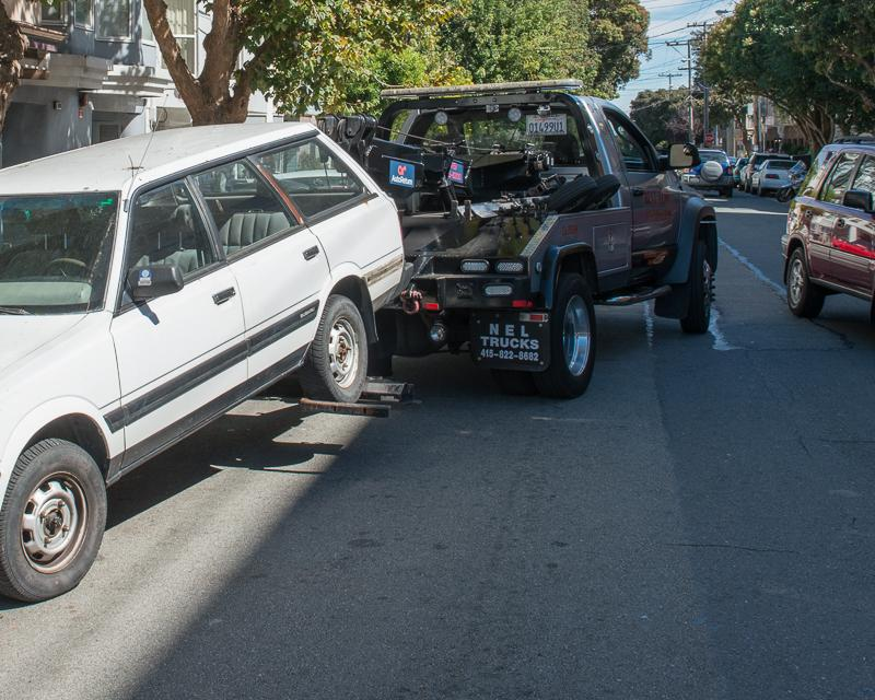 car being towed by tow truck
