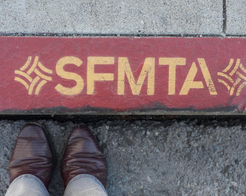 Red color curb with SFMTA writing