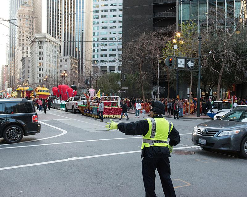 SFMTA Traffic Control Officers assist motorists around the Chinese New Year's parade