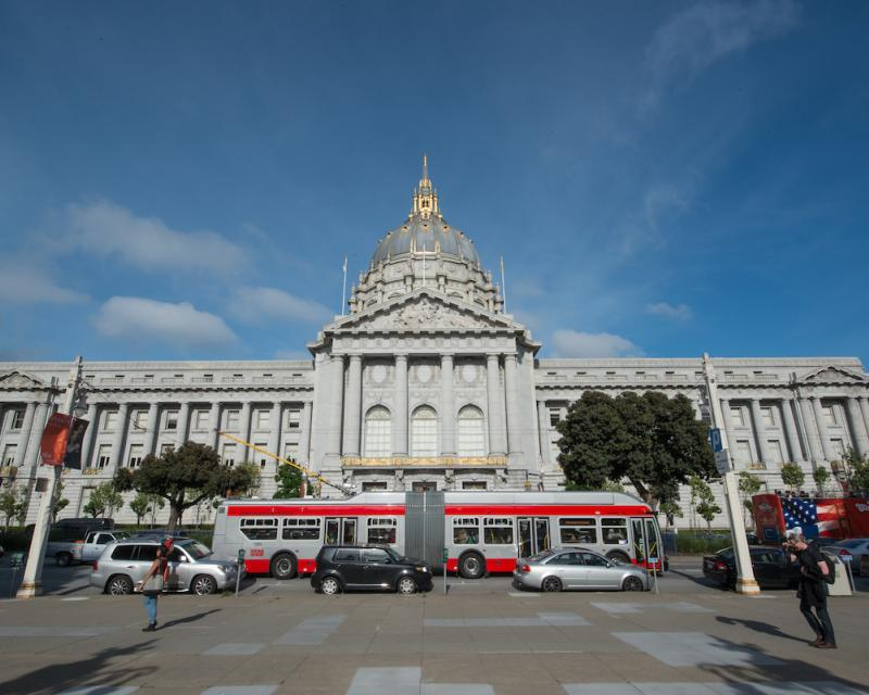 Muni bus in front of SF City Hall on Van Ness Avenue