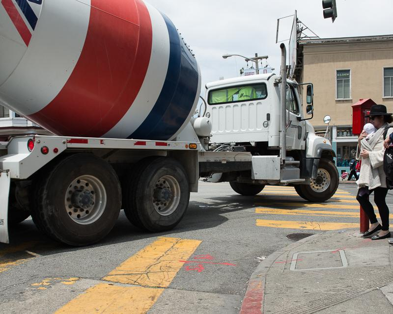 large cement truck turning corner on Broadway