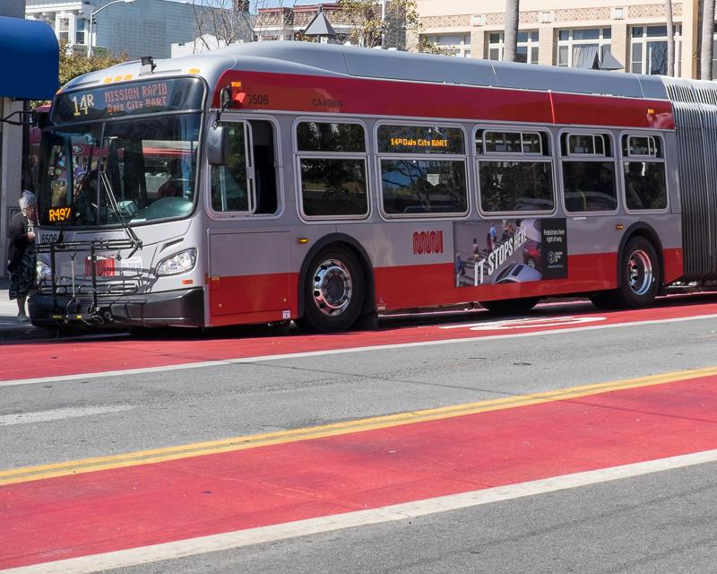 3/4 side view of Muni bus with advertising space on it
