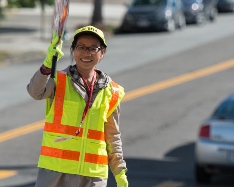 a crossing guard stands at an intersection