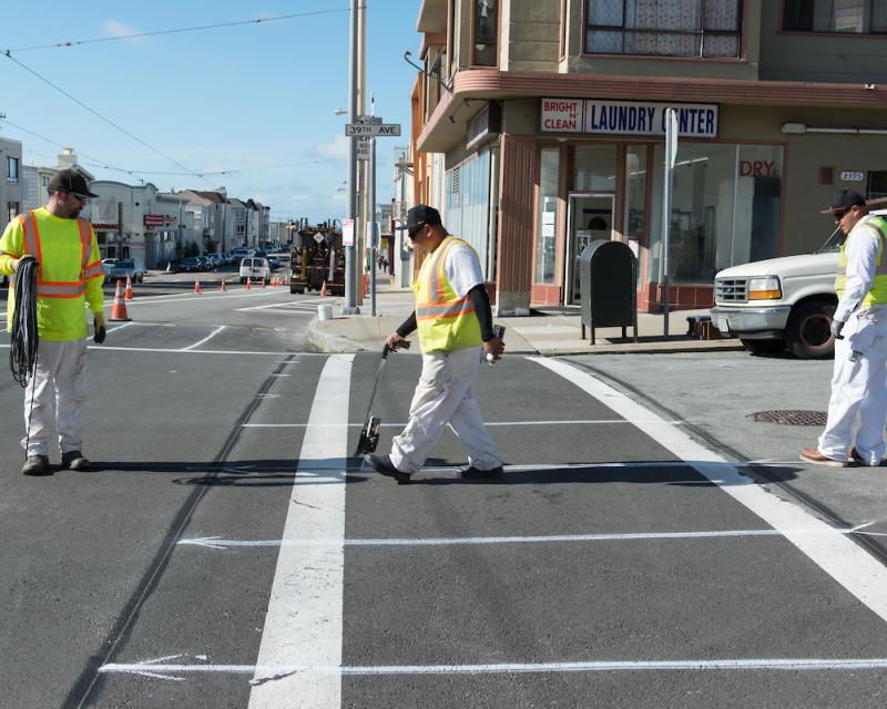 SFMTA staff working on a new crosswalk