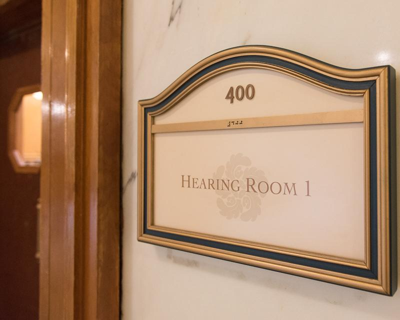 sign for board meeting room 400 in City Hall with door in background
