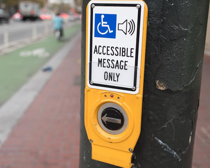 Accessible crosswalk signal button