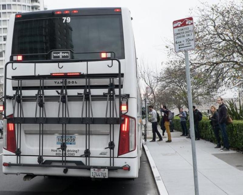 Back of a commuter shuttle in the city